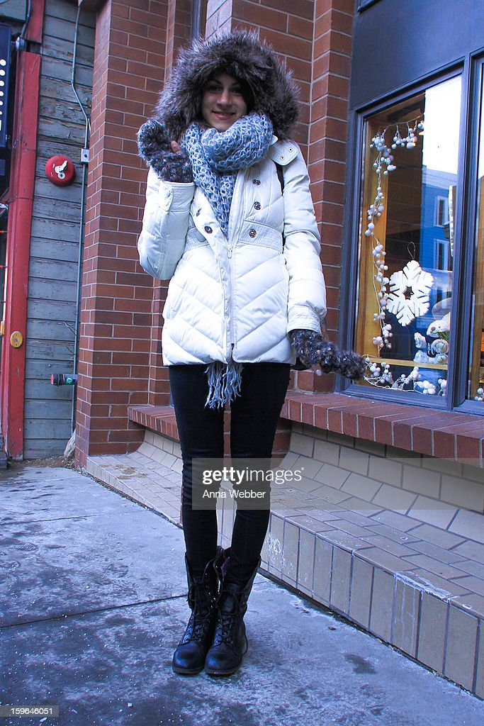 Laura Scarpeti, Publicist from Los Angeles, wearing Juicy Couture coat, Zara scarf, vintage knit gloves, Zara pants and Steve Madden boots on January 17, 2013 on the streets of Park City, Utah.