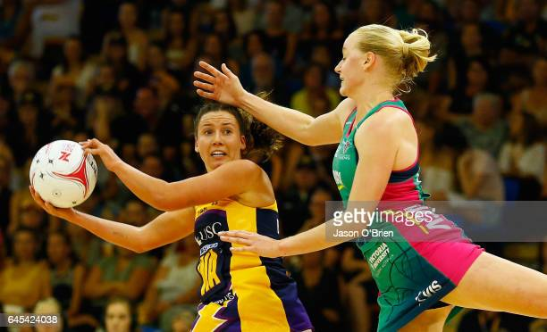 Laura Scherian of the Lightning in action with Chloe Watson of the Vixens during the round two Super Netball match between the Queensland Firebirds...