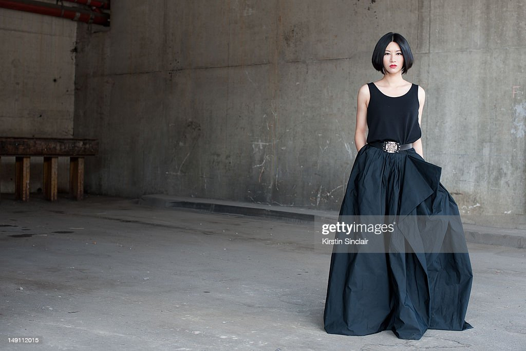 Laura Shang, singer wearing a Lanvin top, skirt, and belt with a vintage ring at Paris Fashion Week Spring/Summer 2013 menswear shows on July 01, 2012 in Paris, France..
