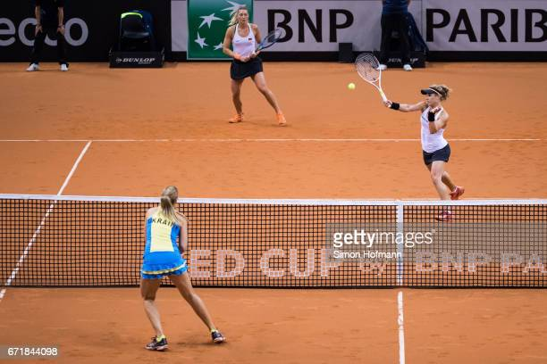 Laura Siegemund and Carina Witthoeft of Germany in action during the doubles match against Olga Savchuk and Nadiia Kichenok of Ukraine during the...