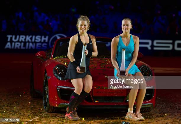 Laura Siegemund of Germany and Kristina Mladenovic of France pose after their match during the Porsche Tennis Grand Prix at Porsche Arena in...