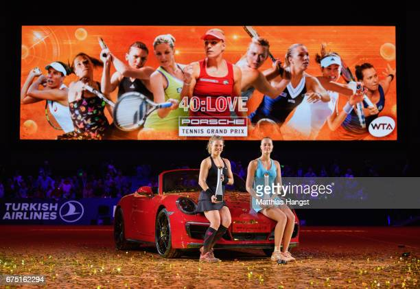 Laura Siegemund of Germany and Kristina Mladenovic of France pose with the trophies after the singles final match on Day 7 of the Porsche Tennis...