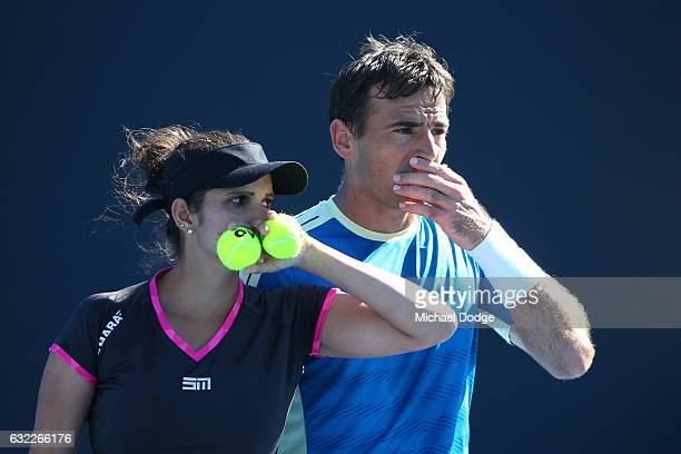 Laura Siegemund of Germany and Mate Pavic of Croatia compete in their first round match against Sania Mirza of India and Ivan Dodig of Croatia on day...