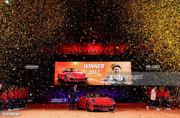 Laura Siegemund of Germany arrives with the winners car Porsche 911 Carrera GTS after the singles final match against Kristina Mladenovic of France...