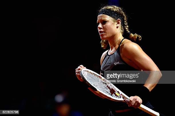 Laura Siegemund of Germany celebrates a point in her match against Simona Halep of Romania during Day 4 of the Porsche Tennis Grand Prix at...