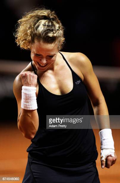 Laura Siegemund of Germany celebrates winniong match point during her match against Karolina Pliskova of the Czech Republic during the Porsche Tennis...
