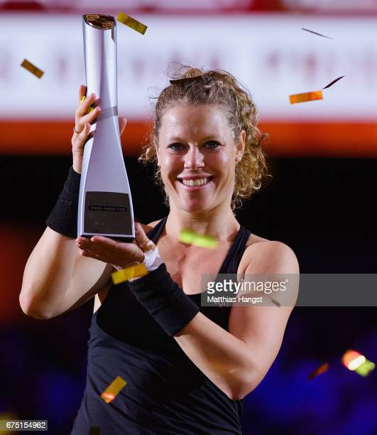 Laura Siegemund of Germany celebrates with the trophy after the singles final match against Kristina Mladenovic of France on Day 7 of the Porsche...