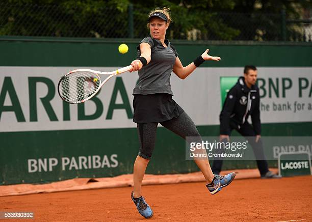 Laura Siegemund of Germany hits a forehand during the Ladies Singles first round match against Eugenie Bouchard of Canada on day three of the 2016...