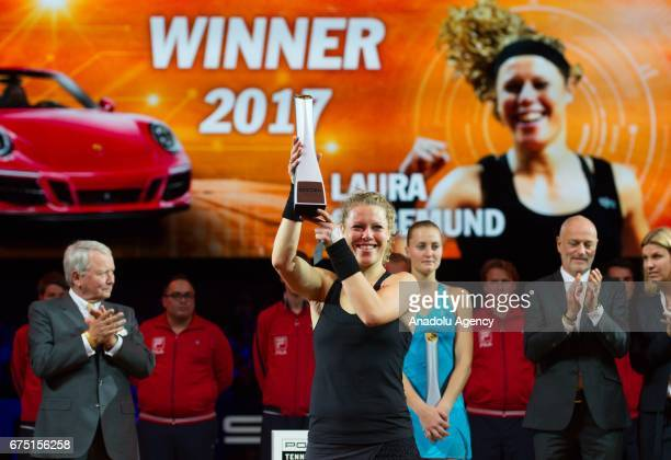 Laura Siegemund of Germany lifts up the trophy after her match against Kristina Mladenovic of France during the Porsche Tennis Grand Prix at Porsche...