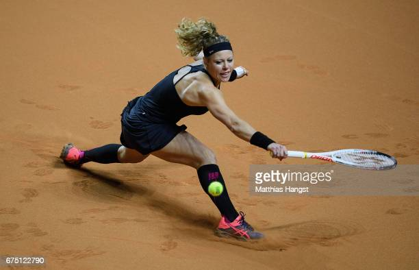 Laura Siegemund of Germany lunges for a backhand during the singles final match against Kristina Mladenovic of France on Day 7 of the Porsche Tennis...
