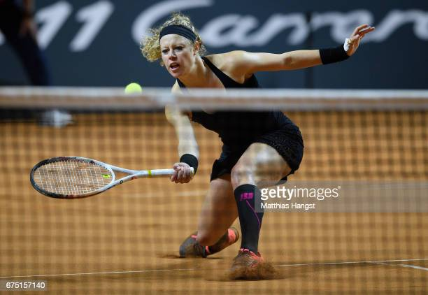 Laura Siegemund of Germany lunges for a forehand during the singles final match against Kristina Mladenovic of France on Day 7 of the Porsche Tennis...