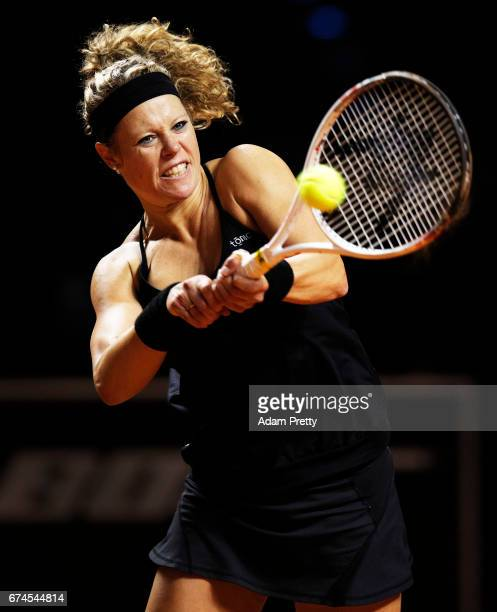 Laura Siegemund of Germany plays a backhand during her match against Karolina Pliskova of the Czech Republic during the Porsche Tennis Grand Prix at...