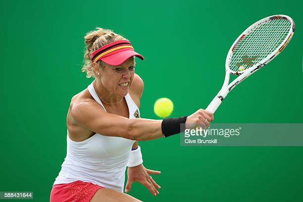 Laura Siegemund of Germany plays a backhand during the women's singles quarterfinal match against Monica Puig of Puerto Rico on Day 6 of the 2016 Rio...