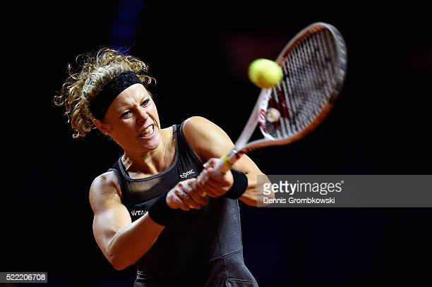 Laura Siegemund of Germany plays a backhand in her match against Polona Hercog of Slovenia during Day 1 of the Porsche Tennis Grand Prix at...