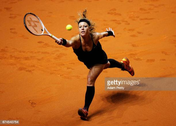 Laura Siegemund of Germany plays a forehand during her match against Karolina Pliskova of the Czech Republic during the Porsche Tennis Grand Prix at...