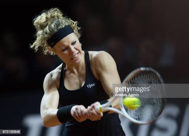 Laura Siegemund of Germany returns the ball to Kristina Mladenovic of France during the Porsche Tennis Grand Prix at Porsche Arena in Stuttgart...