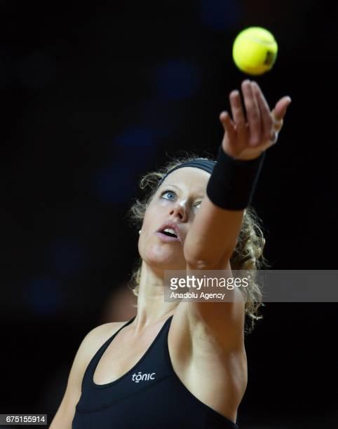 Laura Siegemund of Germany serves the ball to Kristina Mladenovic of France during the Porsche Tennis Grand Prix at Porsche Arena in Stuttgart...