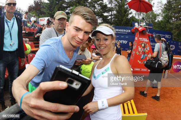 Laura Siegemund of Germany to sign autographs after against Katharina Hobgarski of Germany in the first round during the WTA Nuernberger...