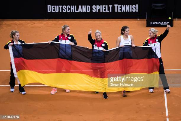 Laura Siegmund Carina Witthoeft Angelique Kerber Julia Goerges and Barbara Rittner of Germany celebrate victory during the FedCup World Group PlayOff...