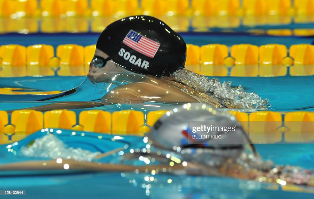 Laura Sogar (L) of the US competes in the women 200m breakstroke final during the Short Course Swimming World Championships in Istanbul on December 16, 2012. Lochte won the race.