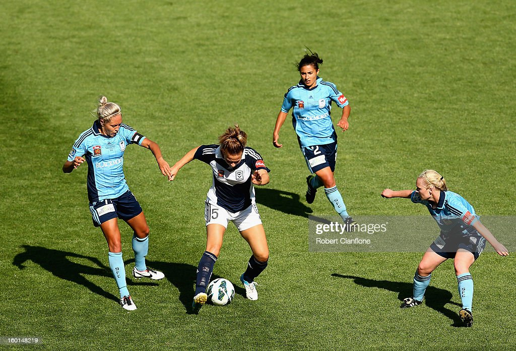 Laura Spiranovic of the Victory is pressured by her opponents during the W-League Grand Final between the Melbourne Victory and Sydney FC at AAMI Park on January 27, 2013 in Melbourne, Australia.