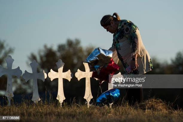 Laura Torres of San Antonio cries as she touches one of the twentysix crosses one for each person killed in the Sutherland Springs First Baptist...