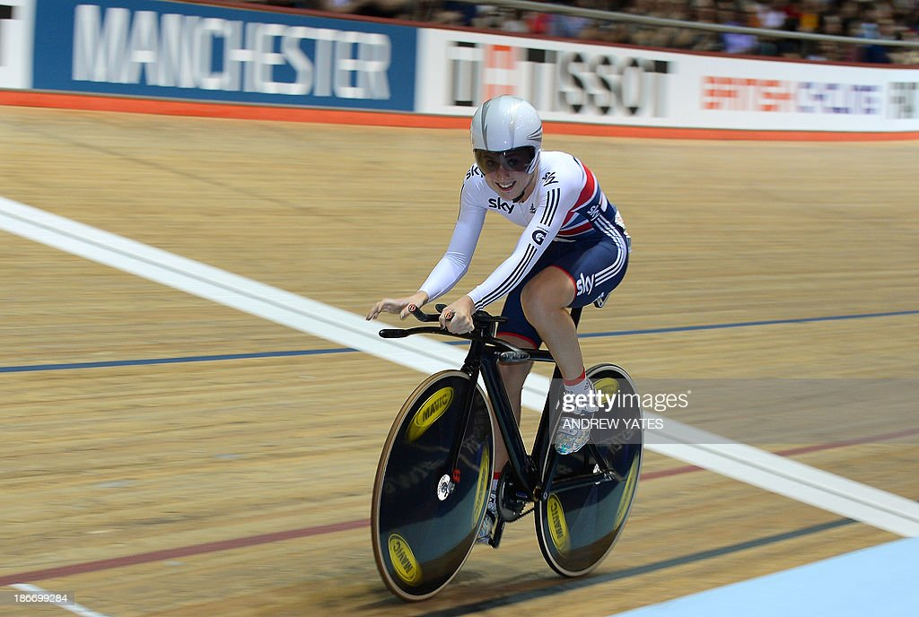 Laura Trott of Great Britain celebrates after winning the women's Omnium on day three of the Track Cycling World Cup at The National Cycling Centre in Manchester, northwest England, on November 3, 2013.