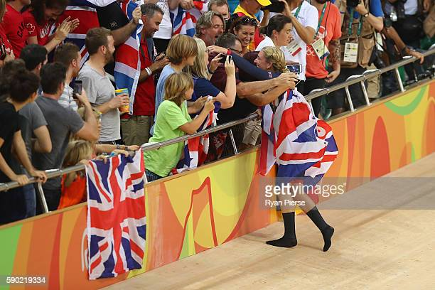 Laura Trott of Great Britain celebrates winning gold in the women's Omnium Points race on Day 11 of the Rio 2016 Olympic Games at the Rio Olympic...