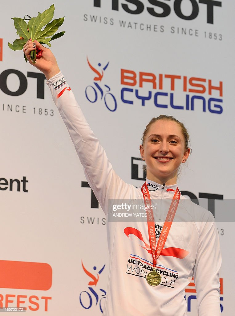 Laura Trott of Great Britain celebrates with her gold medal after winning the women's Omnium on day three of the Track Cycling World Cup at The National Cycling Centre in Manchester, northwest England, on November 3, 2013.