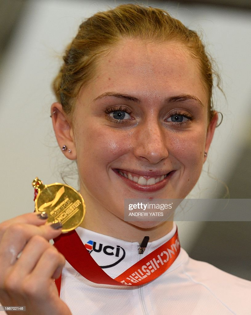 Laura Trott of Great Britain holds her gold medal after winning the women's Omnium on day three of the Track Cycling World Cup at The National Cycling Centre in Manchester, northwest England, on November 3, 2013.