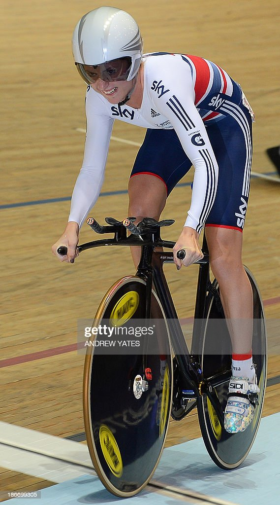 Laura Trott of Great Britain on her way to victory in the 500 Time Trial and the the Women's Omnium on day three of the Track Cycling World Cup at The National Cycling Centre in Manchester, northwest England, on November 3, 2013. AFP PHOTO/ANDREW YATES.