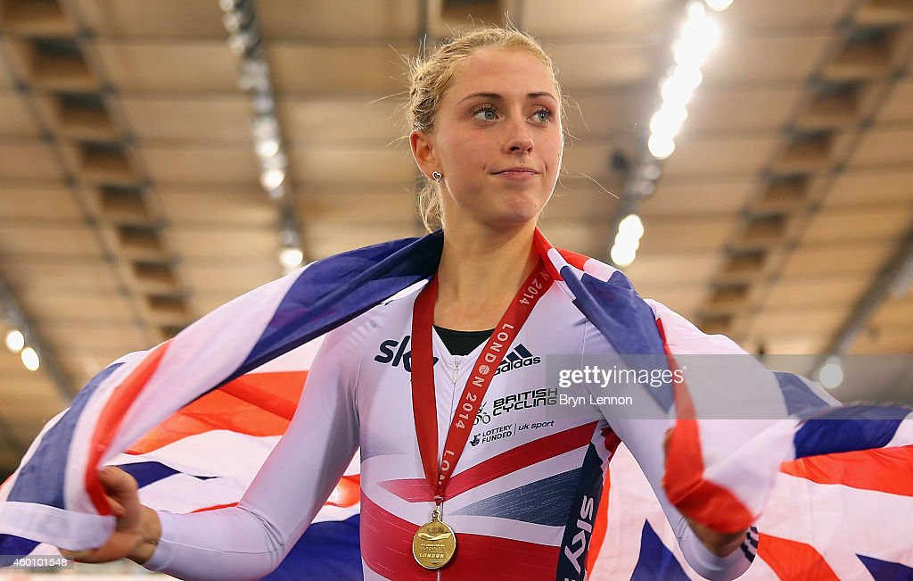 Laura Trott of Great Britain poses with her gold medal and a Union Jack flag after winning the Women's Omnium on day three of the UCI Track Cycling...