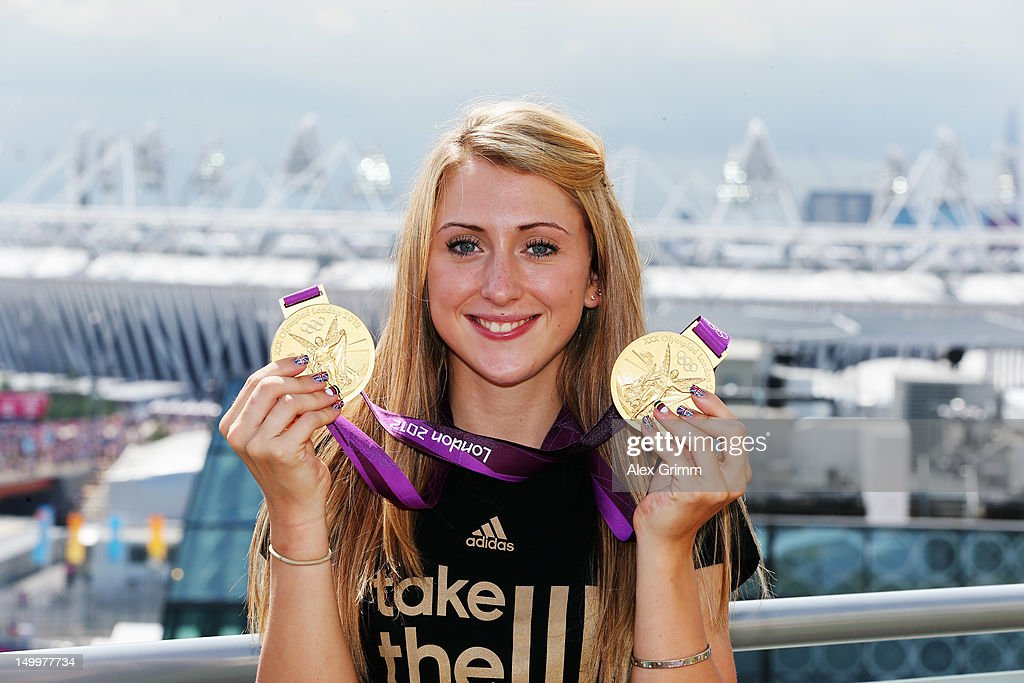 Laura Trott of Team GB poses with her gold medals at the adidas Olympic Media Lounge at Westfield Stratford City on August 8, 2012 in London, England.