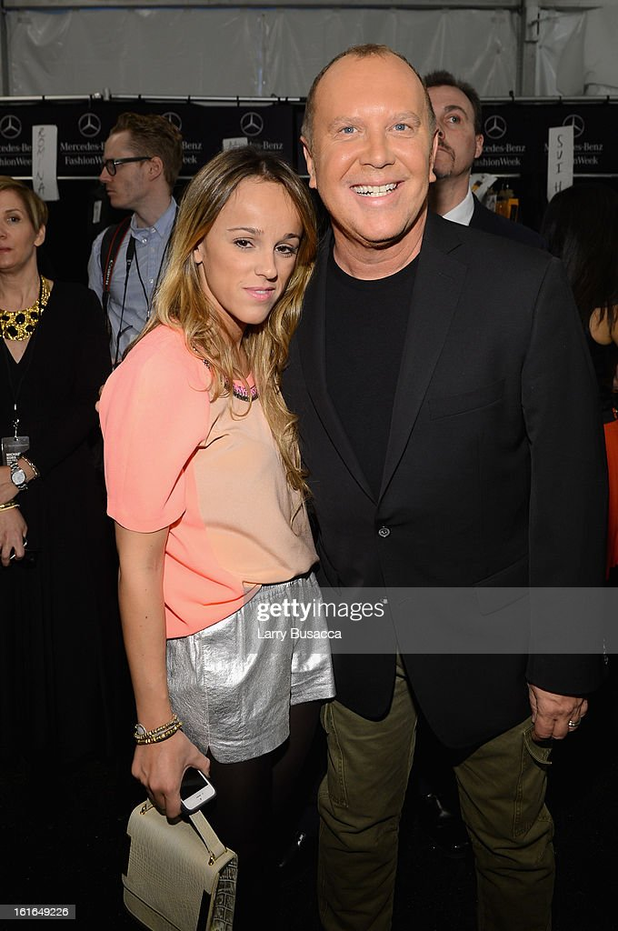 Laura Vela and designer Michael Kors backstage at the Michael Kors Fall 2013 fashion show during Mercedes-Benz Fashion Week at The Theatre at Lincoln Center on February 13, 2013 in New York City.