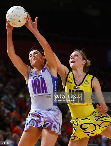 Laura von Bertouch of the Thunderbirds catches the ball over Kimberley Purcell of the Swifts during the Commonwealth Bank Cup semifinal between the...