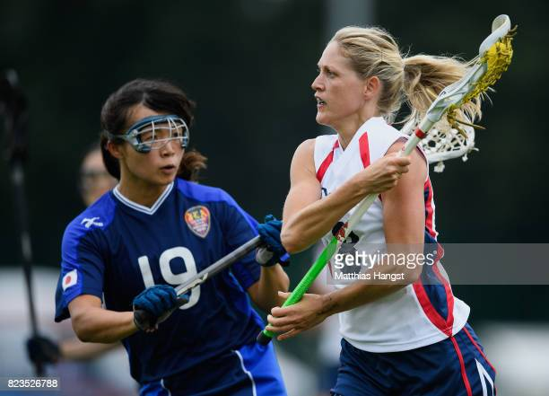 Laura Warren is tracked by Rei Ikeda of Japan during the Lacrosse Women's match between Great Britain and Japan of The World Games at Olawka Stadium...