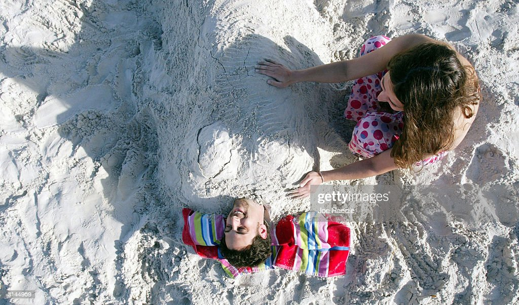 Laura Wayton and Dan Kovach from Ohio University enjoy the beach during spring break March 26 2004 in Daytona Beach Florida As spring break 2004...