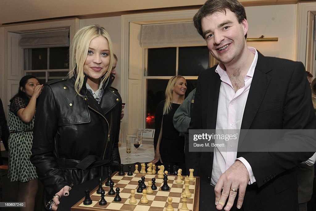 <a gi-track='captionPersonalityLinkClicked' href=/galleries/search?phrase=Laura+Whitmore&family=editorial&specificpeople=5599316 ng-click='$event.stopPropagation()'>Laura Whitmore</a> and chess grandmaster Gawain Jones attend the launch of the 'Urban Chess' Funding Initiative from East Village at Mortons on March 13, 2013 in London England.