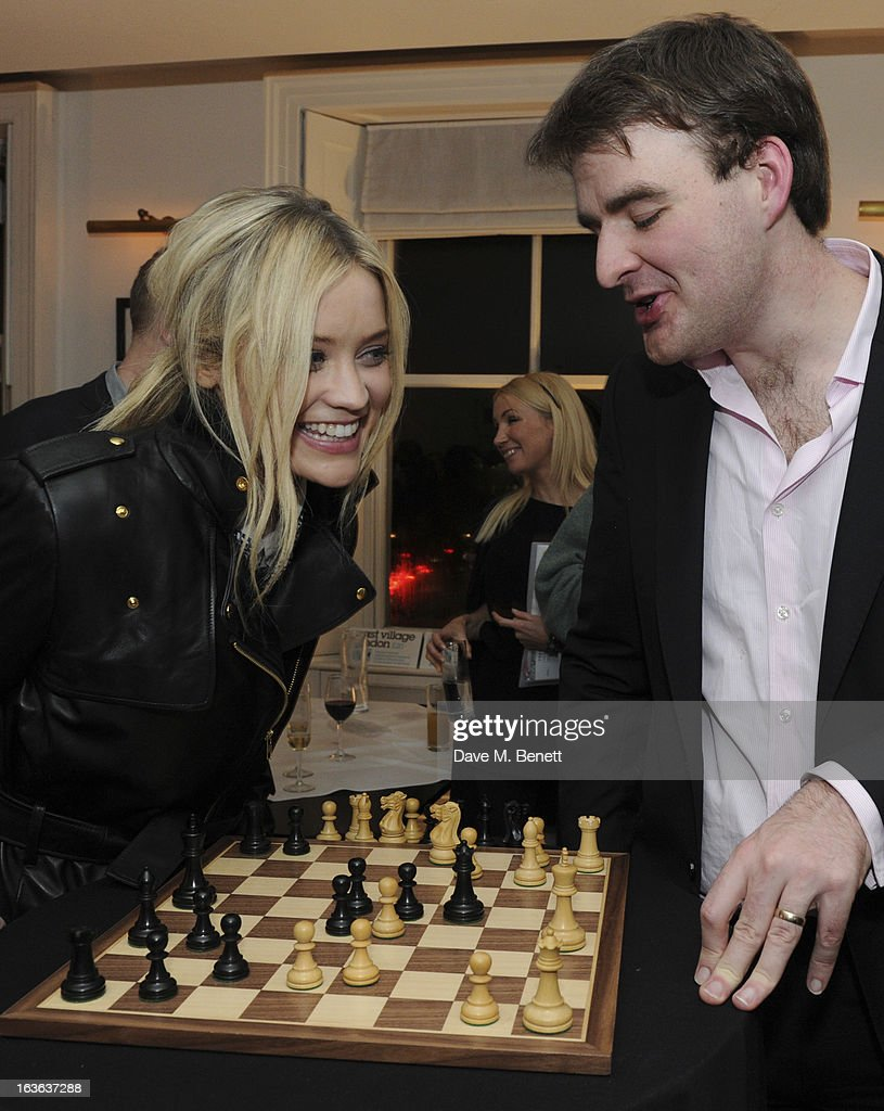 Laura Whitmore and chess grandmaster Gawain Jones attend the launch of the 'Urban Chess' Funding Initiative from East Village at Mortons on March 13, 2013 in London England.