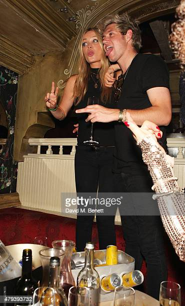 Laura Whitmore and Niall Horan attend the Red Bull Tropical Edition Party at The Box Soho on July 3 2015 in London England Guests enjoyed a...