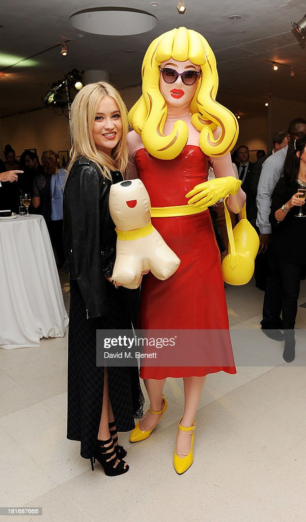 Laura Whitmore (L) and Pandemonia attend the Macmillan De'Longhi Art Auction, raising money for Macmillan Cancer Support, at Royal College of Art on September 23, 2013 in London, England
