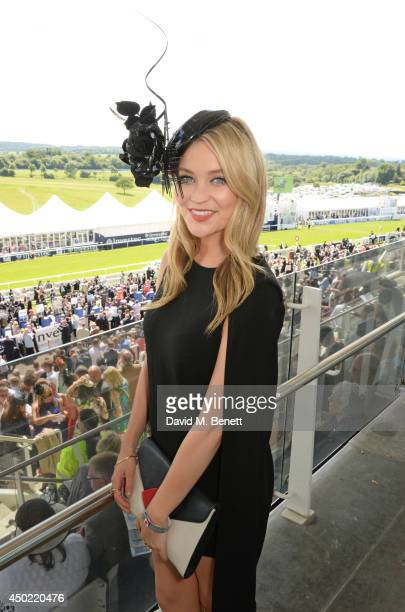 Laura Whitmore attends Derby Day at the Investec Derby Festival at Epsom Downs Racecourse on June 6 2014 in Epsom England