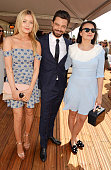 Laura Whitmore Dominic Cooper and Gizzi Erskine attend day two of the Audi Polo Challenge at Coworth Park on May 29 2016 in London England