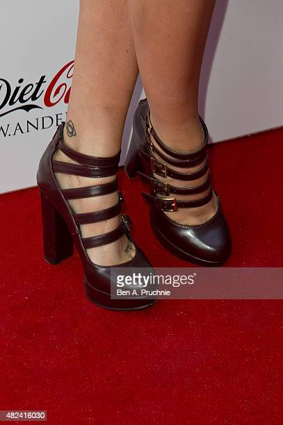 Laura Whitmore shoe detail attends the Diet Coke JWAnderson launch party at Village Underground on July 30 2015 in London England