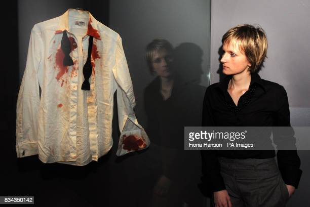 Laura Wilkinson of the Imperial War Museum with the bloodstained shirt worn by James Bond actor Daniel Craig in his first appearance as the 007...