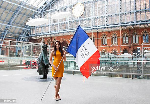 Laura Wright attends a singing flashmob of songs from Les Miserables at St Pancras Station on May 13 2013 in London England