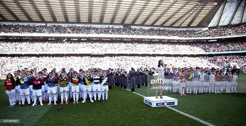 Laura Wright sings the national anthems infront of 100 students from the All Schools programme prior to the RBS Six Nations match between England and Wales at Twickenham Stadium on March 9, 2014 in London, England.