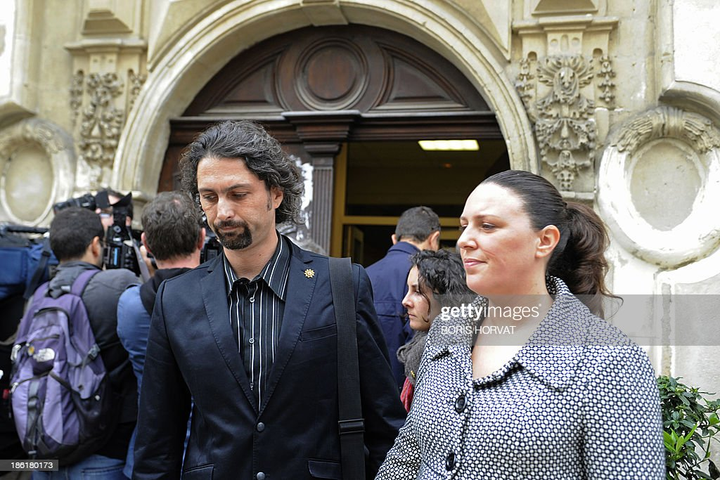 Laure (R) and Nicolas Grimaldi (L), parents of Khoren Grimaldi, the 11-year old boy who was found dead in a corridor of his school in Arles, leave the courthouse in Tarascon, southern France, on October 29, 2013. The boy's teacher, Agnes Lelong, who was charged with 'breach of the duty of care' and 'manslaughter' when Khoren Grimaldi accidentally hung himself on May 26, 2011 after being sent out from class because he refused to do his work, was acquitted by Tarascon's Criminal Court on October 29. AFP PHOTO / BORIS HORVAT