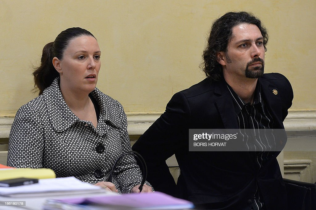 Laure (L) and Nicolas Grimaldi (R), parents of Khoren Grimaldi, the 11-year old boy who was found dead in a corridor of his school in Arles, wait in the courthouse in Tarascon, southern France, on October 29, 2013. The boy's teacher, Agnes Lelong, who was charged with 'breach of the duty of care' and 'manslaughter' when Khoren Grimaldi accidentally hung himself on May 26, 2011 after being sent out from class because he refused to do his work, was acquitted by Tarascon's Criminal Court on October 29.