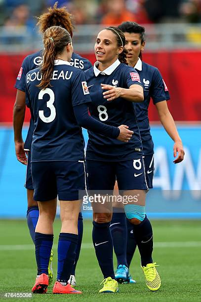 Laure Boulleau and Jessica Houara of France celebrate the win over England during the FIFA Women's World Cup 2015 Group F match at Moncton Stadium on...